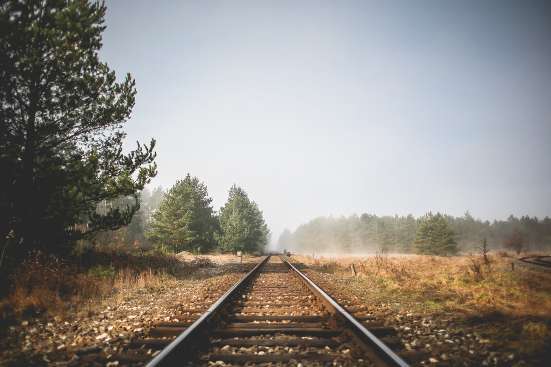 Image of railroad track stretching to the horizon
